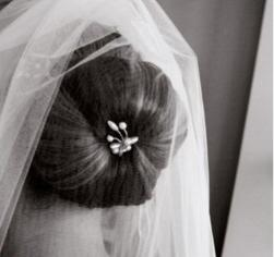 Bride updo with hair clip and veil_picture from the back.jpg
