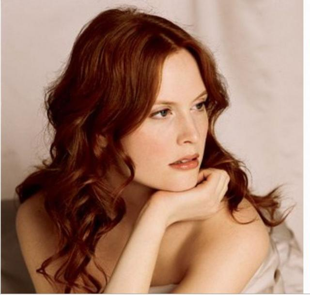 down wedding hairstyle with light curls and long side bangs in red hair.jpg
