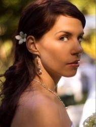 long bride hairstyle with fresh flower hair clip in white and long side bangs.jpg