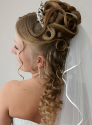 Curly bride hairdo with large tiara and veil .PNG