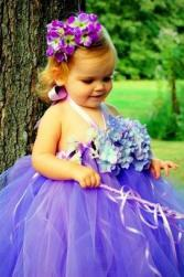 cute picture of flower girl with bright purple flowers.jpg