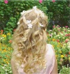 down flower girl hairstyle with small floral hair clilps.jpg