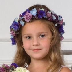 flower girl wreath hairstyle with purple and blue flowers.jpg