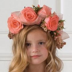 flowers girl wreath hairstyle wtih big peach roses.jpg