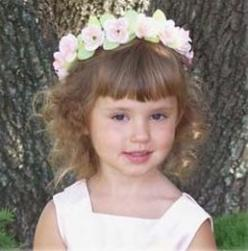 Image of flower girl halo hairstyle with curly hair and bang.jpg