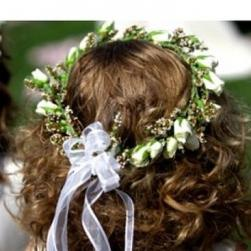 image of flowergirl head wreath hairstyle with small white flowers.jpg