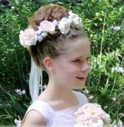 Photo of flower girl hairstyle with bun updo.jpg
