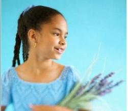 picture of African American flower girl hairdo with purple flowers.jpg