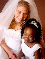 princess looking black flower girl with the bride.jpg
