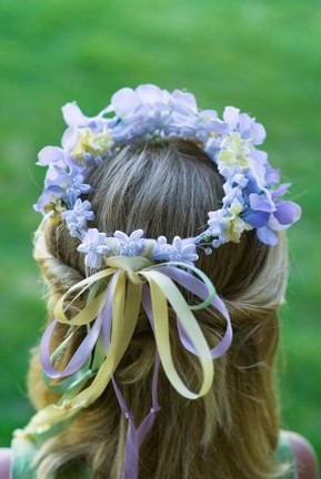wreath flower girl hairstyle with purple and yellow flowers - Copy.jpg