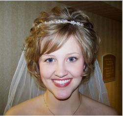 wavy short bride hairstyle with terria and veil with long front bangs.JPG