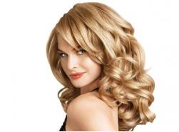 Long curly woman hairstyle with light curly side bangs picture.JPG