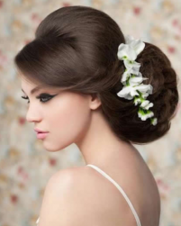 2015 Modern Asian bridal hairdo with with white flowers and long side bangs.PNG
