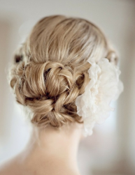 2014 modern updo hairstyles for wedding with large floral hair clip.PNG
