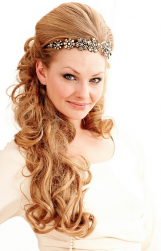 Goddesh wedding hairstyle with crystal hair clips with very long curly hair with bang pulled to the back.PNG