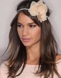 Modern wedding braidmaid hairstyle with big floral hair banh.PNG
