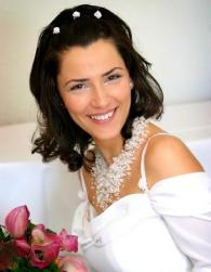 Down wedding hairstyle with medium hair length with white hairclips.JPG