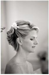 Simple and wavy short wedding hairstyle with flower clip with side bangs.JPG