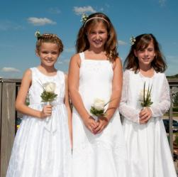 Three pretty flower girls with their own special flowergirls hairstyles.JPG