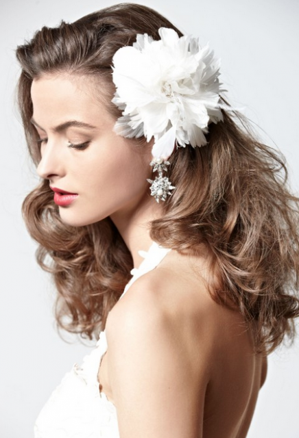 Down hair wedding hairstyle with big white flower hairclipg mightylinksfo