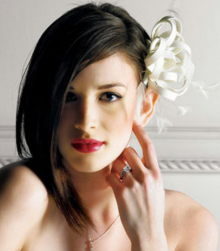Medium wedding hairstyle with straight very long swept bangs with modern hair clip.PNG