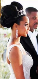Beautiful African American bride hairstyle with knobs and hairclips gives you a chic wedding updo.PNG