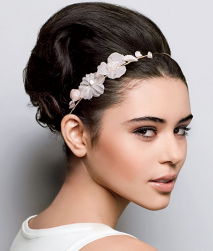 Trendy bridal hairstyle with small floral headband.PNG