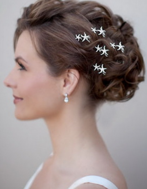 Elegant wedding updo with sea stars hair clips.PNG