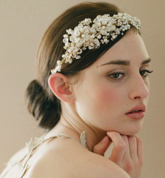 Bridal hairstyle with beautiful crystal and pearl headband.PNG