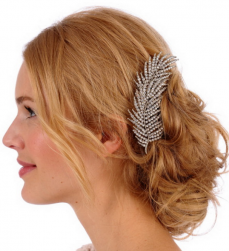 Wedding hairstyle with lower updo hairstyle with Crystal feather and long side bang.PNG
