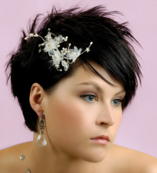 Very short bridal hairstyle with spiky short hair with layers and floral hairclip.PNG