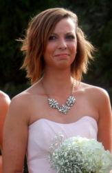 Medium layered bridal hairstyle with long layered side bangs with highlights.JPG