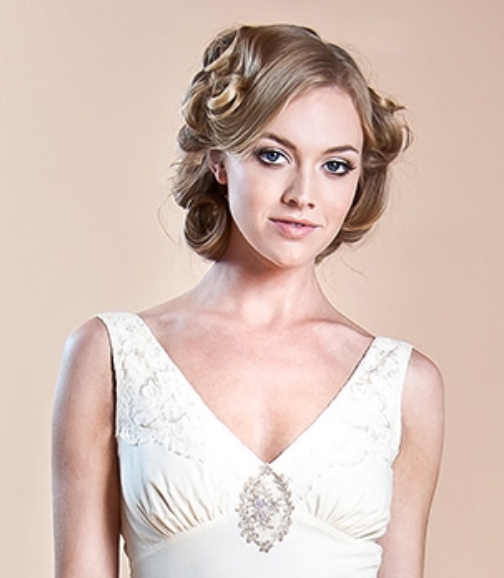 Curly bridal hairstyle with a mixed of straight and curls hair.PNG