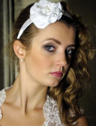 Wedding hairdo with curls and large white flower headband.PNG