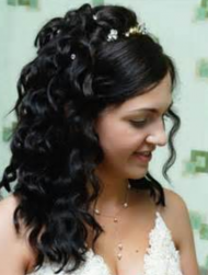 Curly bridal hairstyle with half up hairdo with tiny crystal hairclips and long side bang.PNG
