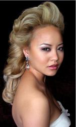 Asian bridal hairstyle in blonde hair and big light rolls and high bang.JPG