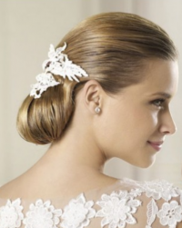 Elegant wedding hairdo with white wedding hairclip.PNG