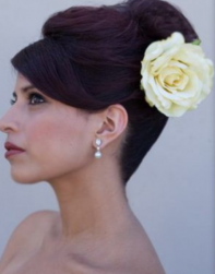 Wedding classic updo with fresh white lfower hair clip and long swept bang.PNG