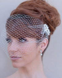 Red hair wedding hairstyle with trendy updo with swept bang.PNG