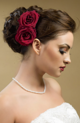 Timeless wedding hairstyle with red roses hairclips.PNG
