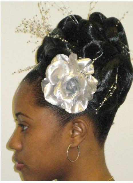 African wedding hairstyle with white floral hairclips.JPG