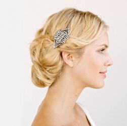 Wedding hairdo with classic low updo with crystal brooch.JPG