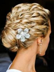 Wedding hairstyle with waves and jewelry pin.JPG