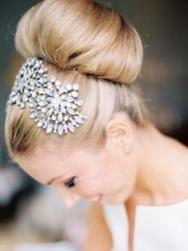 Wedding hairstyle with knot with unique crystal hairclips.JPG