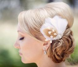 Wedding updo with lon swept bang with feather hairclip.JPG