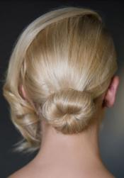 Simple wedding hairstyle with back knot and side bang.JPG