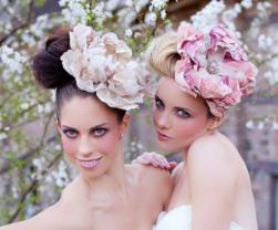 Bridesmaids hairstyle 2015 with large fresh flowers.JPG