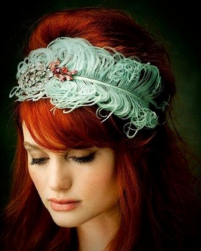 Red hair bridemaid hairdo with teal greenish fleather hairslip.PNG
