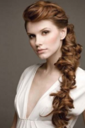 Long curly wedding unique hairdo on one side.PNG