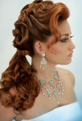 Red hair wedding hairstyle with curls and low updo with curly side bang.PNG